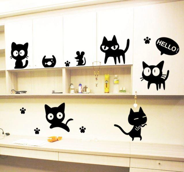 čierna mačička holenie